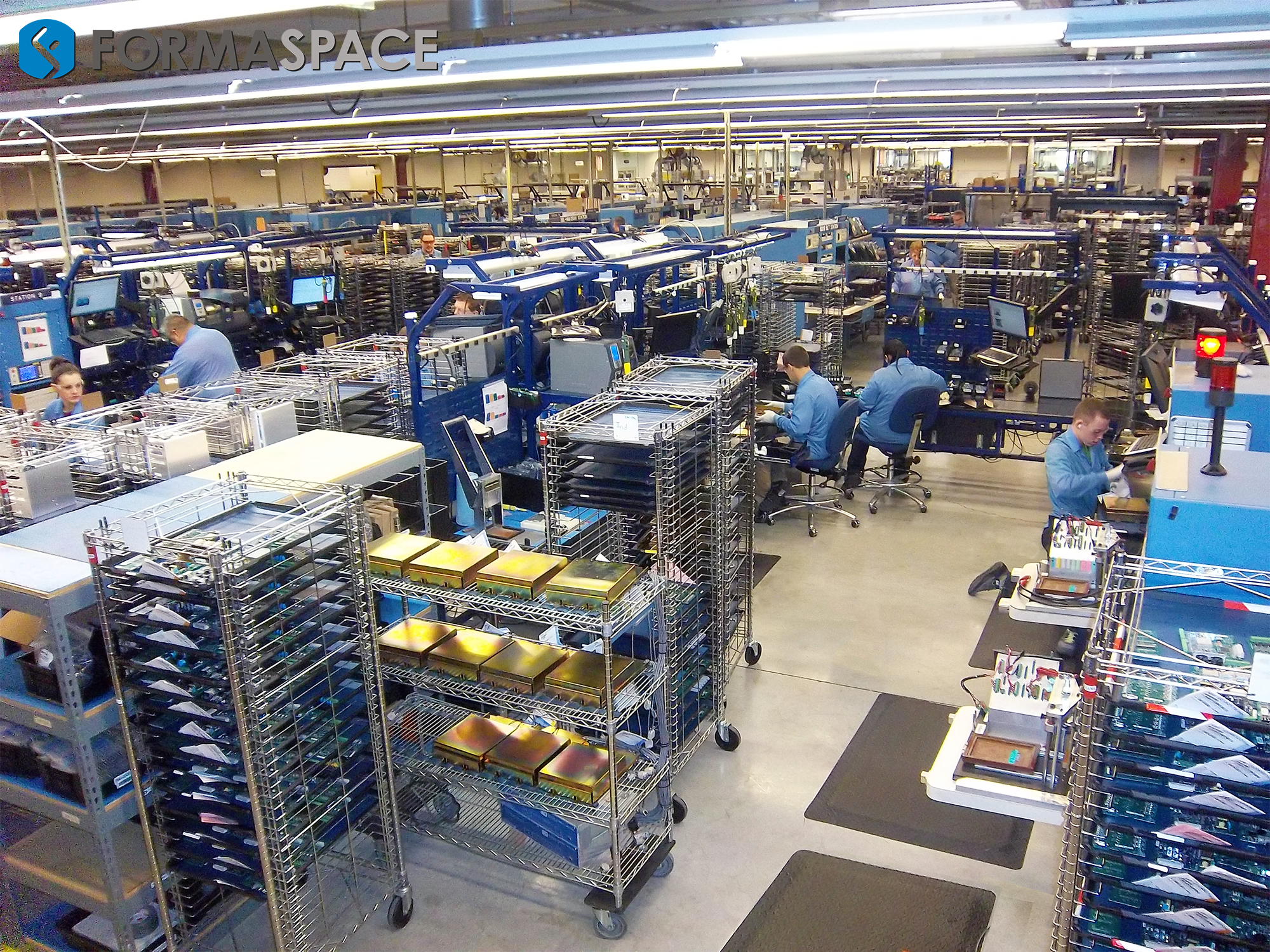 electronics-tech-lab-workers-industrial-racks