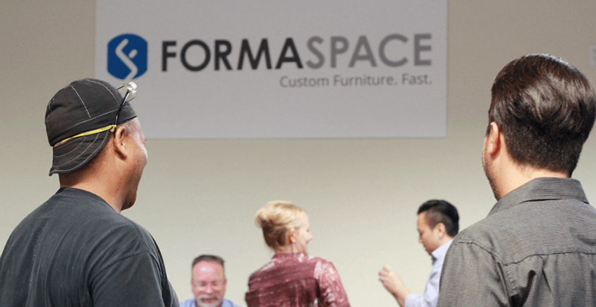 formaspace employees celebrating green initiative