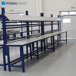 oil and gas maintenance facility industrial workbenches with angled upper shelves