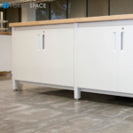 IT Innovation Lab with Island Table and Lockable Storage