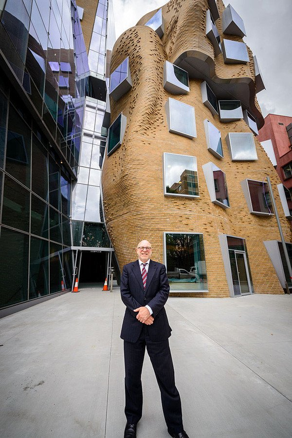 Professor Roy Green stands in front of the new Frank Gehry designed Dr Chau Chak Building in Sydney.
