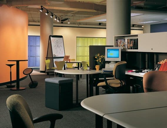 "Collaboration circa 1996 at Autodesk/Kinetix building in San Francisco at the beginning of the dot-com boom. Note blue and green lockers built into far wall for teleworkers coming into the office, and the ""rocker"" bar stools which encourage impromptu meetings-- just don't linger too long. Architect HOK, interiors Millican/Jones."